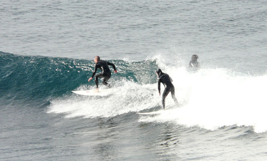 surfing in playa mojon